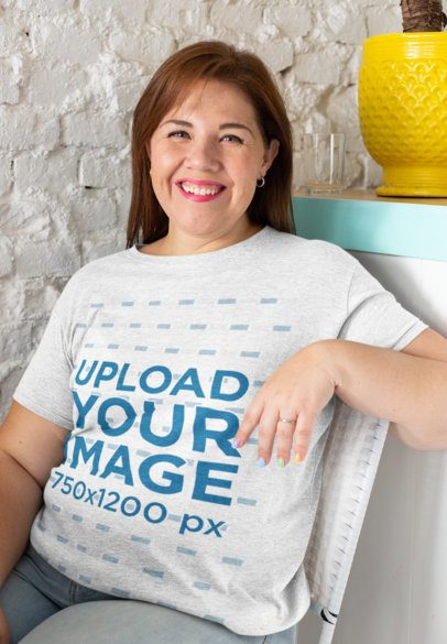 Heathered T-Shirt Mockup of a Woman Smiling at a Restaurant 28802