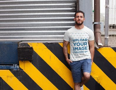 Mockup of a Tattooed Man Wearing a Heather T-Shirt in a Loading Zone 28621