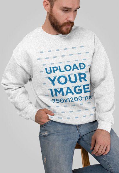 Heathered Crewneck Sweatshirt Mockup Featuring a Man Sitting on a Stool 28745