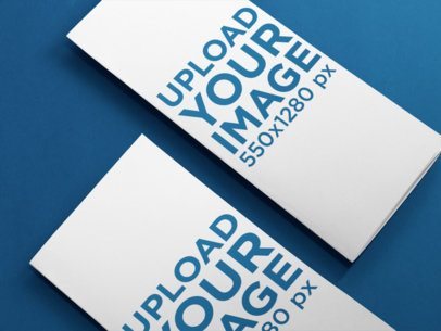 Mockup Template of a Set of Trifold Brochures Lying Over a Solid Surface a10300
