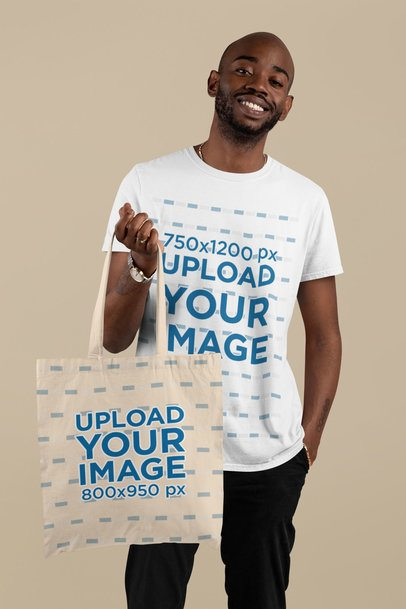 T-Shirt Mockup of a Man Holding a Tote Bag in a Studio 29432