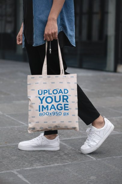 Cropped Face Mockup of a Man Holding a Tote Bag in the Street 29424