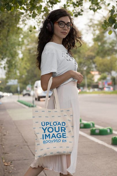 Tote Bag Mockup of a Woman with Headphones on the Street 29452