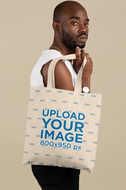 Mockup Featuring a Serious-Looking Man Carrying a Tote Bag over His Shoulder 29449