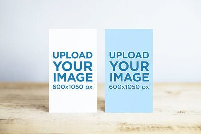 Mockup of Two Vertical Business Cards on a Wooden Surface 745-el