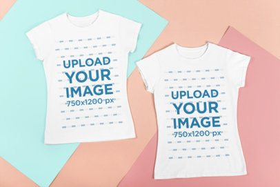 Mockup of Two Best Friend Tees Flat-Laid Over Colorful Cardboards 29641