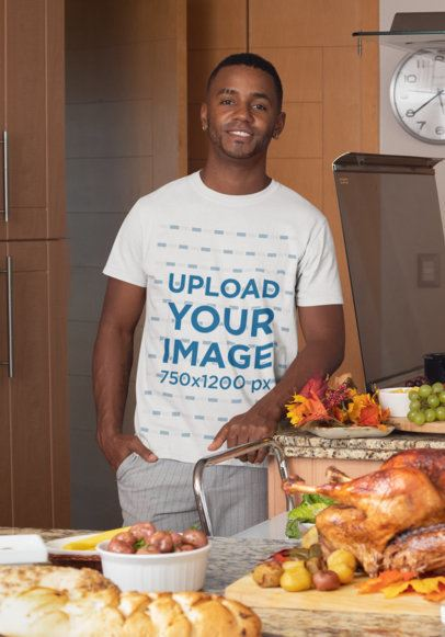 Mockup of a Smiling Man Wearing a Customizable T-Shirt During a Thanksgiving Dinner 30107