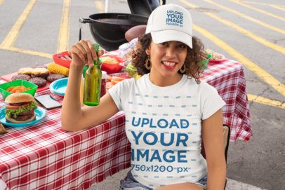 T-Shirt Mockup of a Curly-Haired Woman With a Trucker Hat at a Tailgate Party 29898