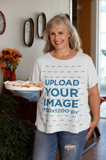 Mockup of a Woman Wearing a T-Shirt and Holding a Pie at Thanksgiving 29942