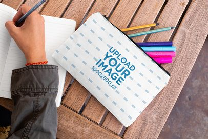 Pouch Mockup of a Woman Writing in a Notebook 29976