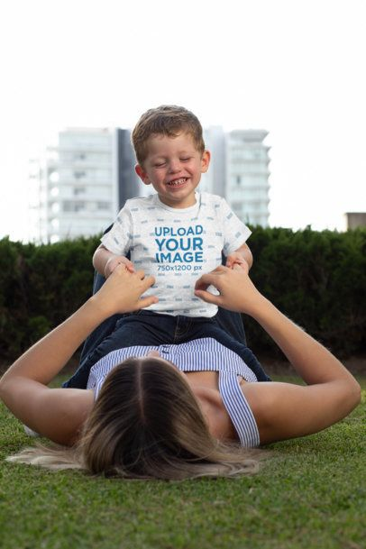 Heather Mockup of a Baby Boy Wearing a Onesie and Playing with His Mom 29911