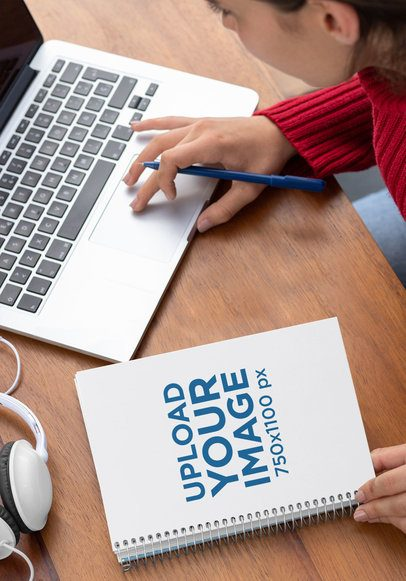 Spiral Notebook Mockup of a Woman Working on Her Desk 29945