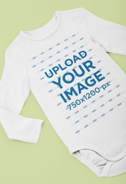Long Sleeve Onesie Mockup Over a Minimalistic Surface 29840