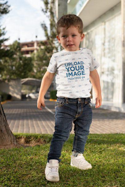 Short-Sleeve Heather Onesie Mockup Featuring a Boy Posing in the Backyard 29913
