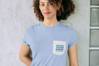 Pocket Tee Mockup of a Woman Wearing a Tee Against a Concrete Wall 30064