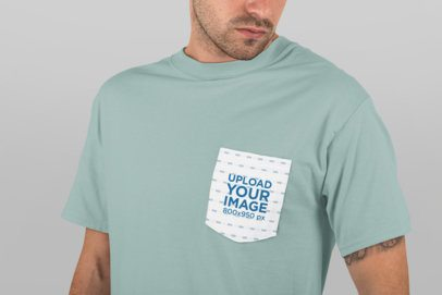Mockup of a Man Wearing a Tee with Pocket in a Studio 30005