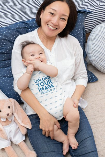 Mockup of a Baby Boy Wearing a Heathered Onesie Smiling with His Mom 30045