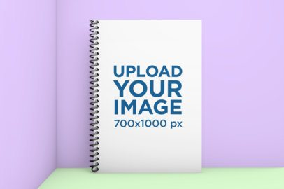 Mockup of a Spiral Notebook Placed Against a Two-Tone Background 1007-el