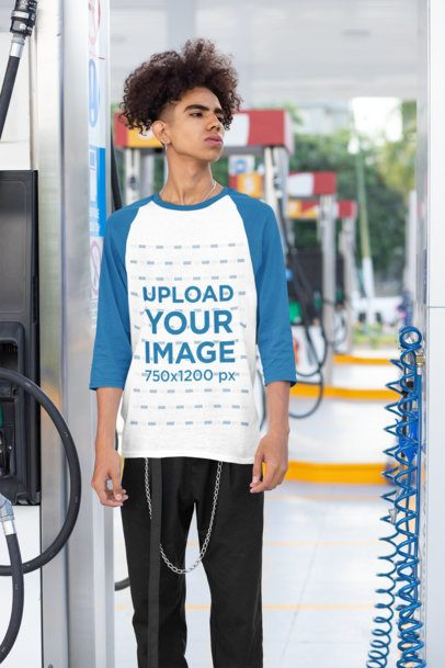 Mockup of a Young Man at a Gas Station Wearing a Raglan Tee with Three-Quarter Sleeves 30206