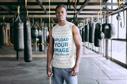 Mockup of a Serious Man Wearing a Tank Top at a Boxing Gym 30159