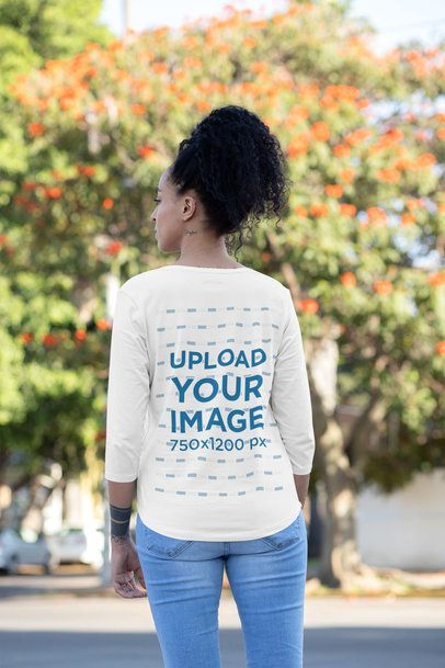 Mockup of a Woman Wearing a Three-Quarter Sleeve T-Shirt Outside 30230