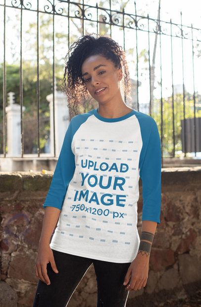Mockup of a Curly-Haired Woman Wearing a Raglan Three Quarters Sleeve Tee 30236