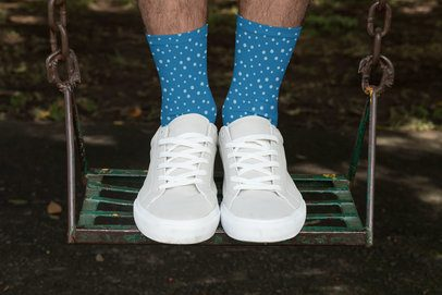Sublimated Socks Mockup Featuring a Man Standing on a Swing 29557