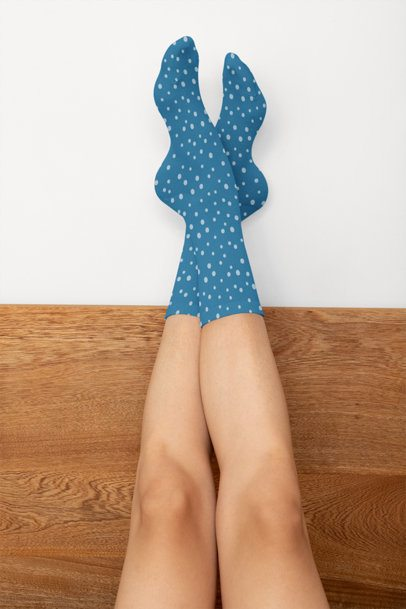 Socks Mockup Featuring a Woman with Her Feet Up Against a Wall 29533