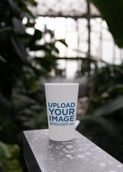 Reusable Cup Mockup Featuring a Natural Background 30562