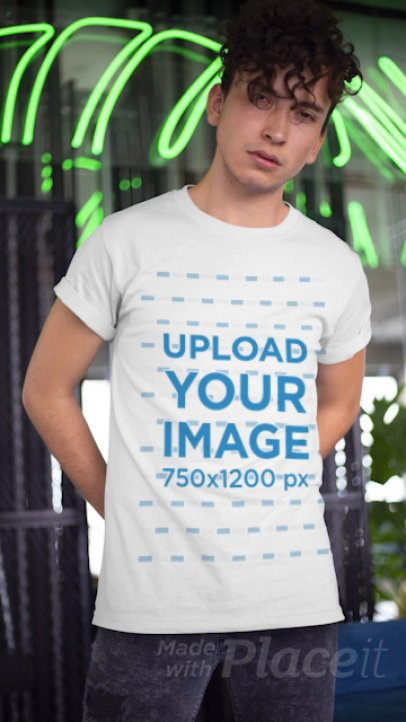 T-Shirt Video Featuring a Young Man Posing by Some Neon Light Reflections 22464