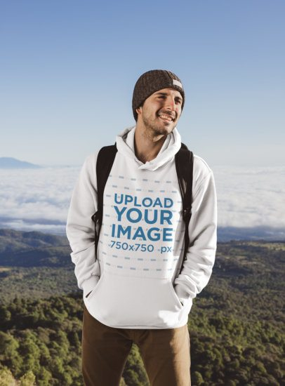 Hoodie Mockup of a Man at the Top of a Hill 30501