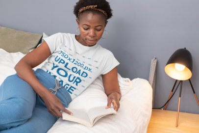 T-Shirt Mockup of a Woman Reading on Her Bed 30333
