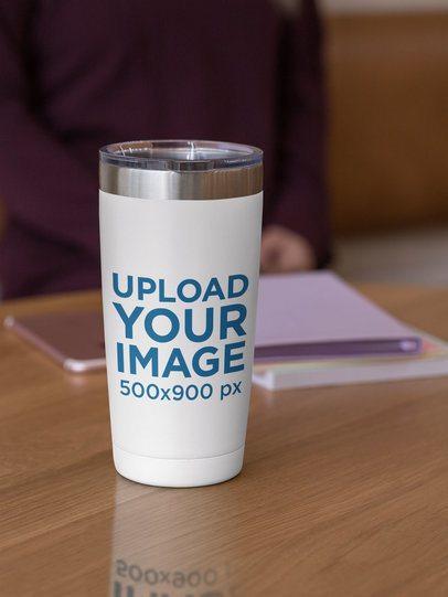 Mockup of a 20 oz Travel Mug over a Wooden Surface 30413