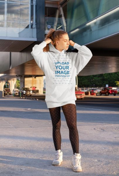 Mockup of a Woman Wearing a Hoodie Dress on the Street 30572