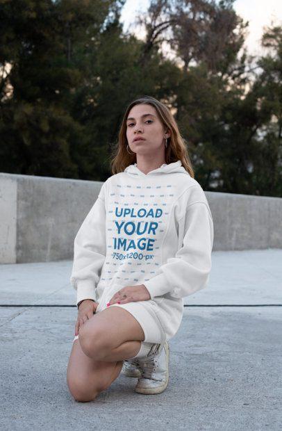 Mockup of a Woman Wearing a Hoodie Dress in an Urban Setting 30573