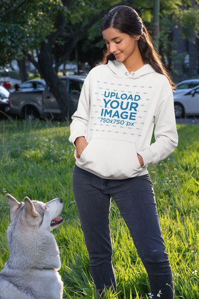 Hoodie Mockup of a Woman in the Park with Her Dog 30664