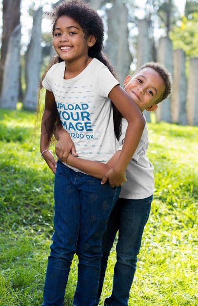 T-Shirt Mockup of Two Siblings Playing at a Park 30593