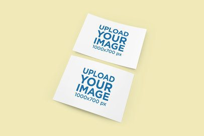 Mockup of Two Greeting Cards Lying on a Solid Color Background 1122-el