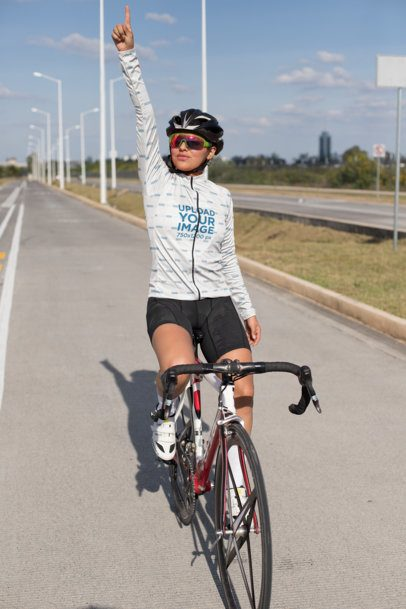 Mockup of a Cyclist with a Long Sleeve Cycling Jersey Celebrating on the Road 30779