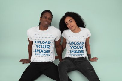 Crew Neck T-Shirt Mockup of a Couple Sitting at a Studio 30763