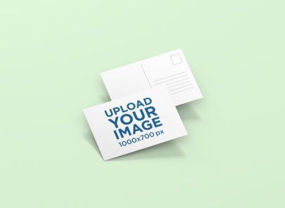 Front and Back View Mockup of a Postcard 1225-el