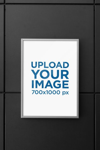Mockup of a Framed Poster Hanging on a Dark Modern Wall 1351-el