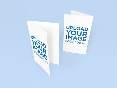 Mockup of Two Greeting Cards Slightly Opened Against a Plain Backdrop 1137-el