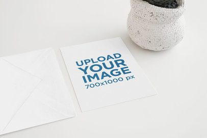 Mockup of a Greeting Card and an Envelope Beside a Small Plant Pot 938-el