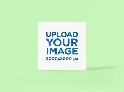 Mockup of a Square Booklet Standing Against a Plain Color Backdrop 1510-el