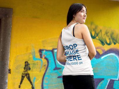 Happy Asian Girl Wearing a Tank Top Mockup Near a Graffiti a9540b