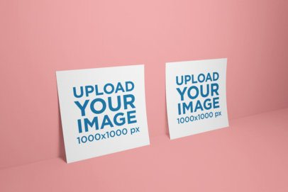 Mockup of Two Square Flyers Standing Against a Solid Background 1749-el