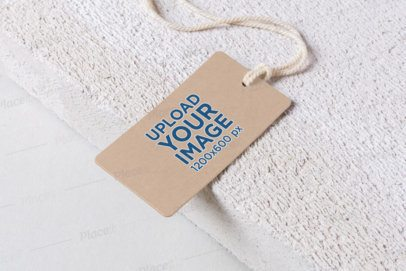 Mockup of a Cardboard Label Tag at the Edge of a Textured Surface 1675-el