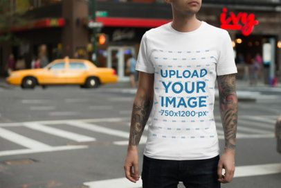 T-Shirt Mockup of a Tattooed Man at a City Crosswalk 1939-el1