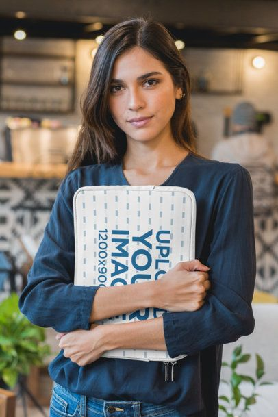 Mockup of a Woman Holding a Laptop Sleeve 30848